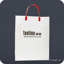 Saco de compras de papel de luxo com alça rígida