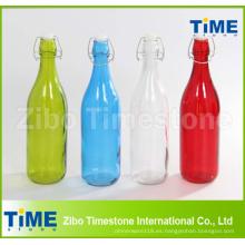 Botella de vidrio colorida con tapa