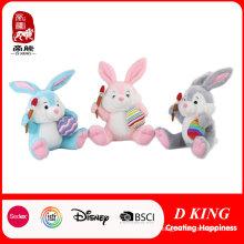 Brinquedos macios do coelho feliz de Easter com ovo e pastel