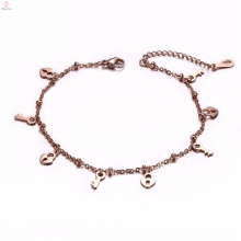 Venda quente simples rosa ouro granel fechadura chave encantos pulseira tornozeleira