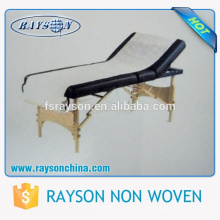 O tipo de Rayson do chinês fez a tampa de cama descartável plástica revestida plástica da massagem do PE do hospital