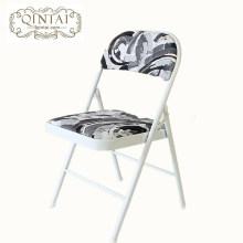 La estructura metálica barata al por mayor de la silla plegable con la parte posterior y el asiento de la PU imprimió los muebles plegables negros de la bandera americana