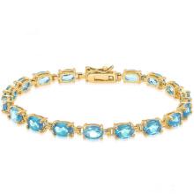 Oro 14k sobre plata esterlina Gemstone Tennis Style pulsera con topacio azul