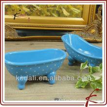Bañera de cerámica de forma oval de color azul mini