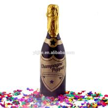 Botella de confeti de Champagne con círculo colorido de papel metálico