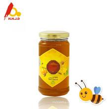 Roher Polyflower-Honig auf der Haut