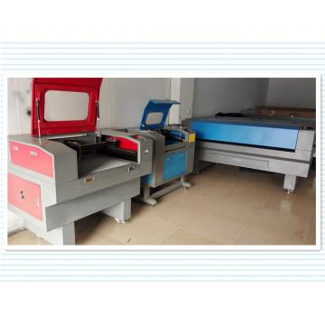 Máquina de corte a laser de venda quente para tecido / pano / couro