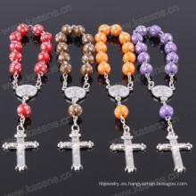 Nuevas estrellas del diseño rebordean el chaplet del rosario de la manera con la cruz del metal