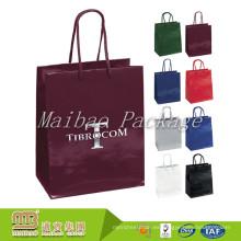 Bolsas de papel de lujo de la mercancía brillante de la pequeña cantidad al por mayor de encargo para el embalaje de las compras de la ropa