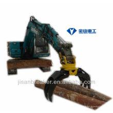 La pinza hidráulica KUBOTA KX161, el accesorio para excavadora, la grapa de madera