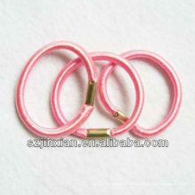 Lazo de pelo elástico rosa con puntas de metal