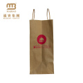Chine Sac à provisions en papier Kraft brun en gros fait sur commande réutilisable écologique de magasin de papier