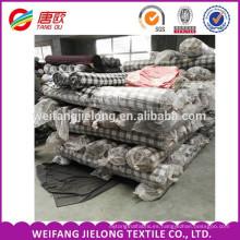 En stock En venta en stock tela de franela teñida hilado cuadros a la venta tela stock de franela 100% algodón