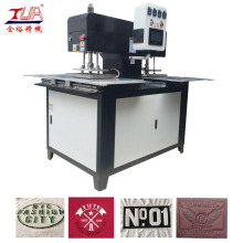 Jeans pattern and trademark embossing machine