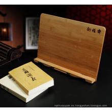Soporte de libro de madera grabado por encargo del laser, tenedor del cojín