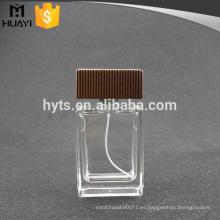 Perfume de botella de vidrio de 100 ml con tapa de madera