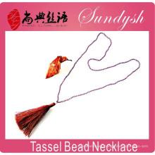 La última joyería de invierno collar de borla hecha a mano único collar cristalino del grano largo