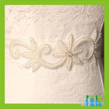 coser pedrería de cristales para cinturones nupciales de boda