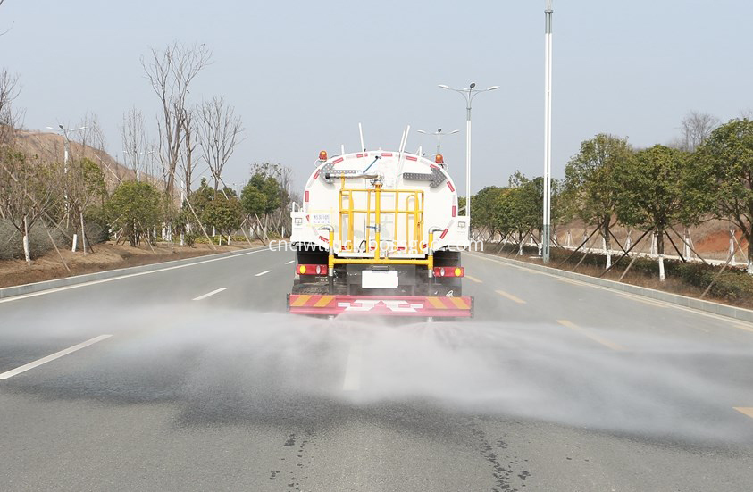 water spray truck in action 2