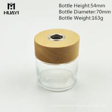 fabricante cilindro 100ml coloreó la botella de cristal decorativa del difusor de lámina