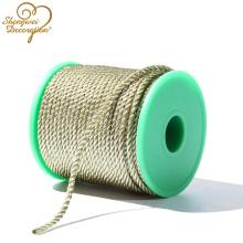Cable retorcido metálico dorado de 5 mm