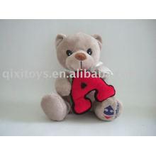 muñeco de peluche relleno sosteniendo una carta, juguete educativo animal