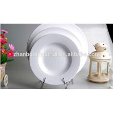 Placa plana redonda de porcelana de color blanco duradero