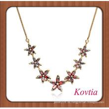 Afrikanisches Gold überzogene Art und Weise rote Kristallblumenkette Halskettengroßverkauf 99 cent Speichereinzelteile
