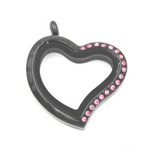 Schwarzes überzogenes halbes rosafarbenes Kristallherz geformtes Glas Locket