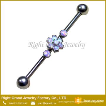 La punta de acero quirúrgico fijó la perforación industrial púrpura del Barbell del ópalo de fuego sintético