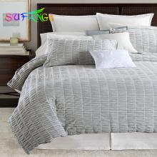 La tira de satén al por mayor juegos de edredón de lujo juego de cama edredón blanco cubre la sábana del hotel