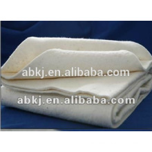 Garment interlining needle punched cotton filling
