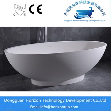 Oval solid surface bathtub