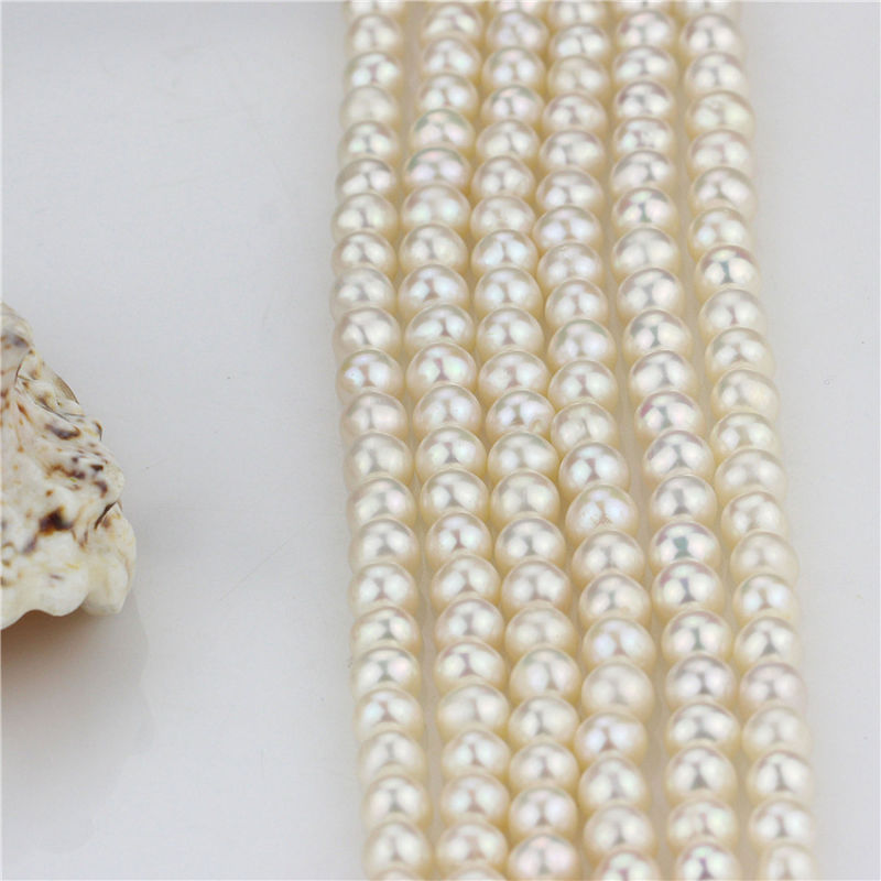Size 7mm Freshwater Near Round Loose Strand Grade AA White Color Genuine Pearl String