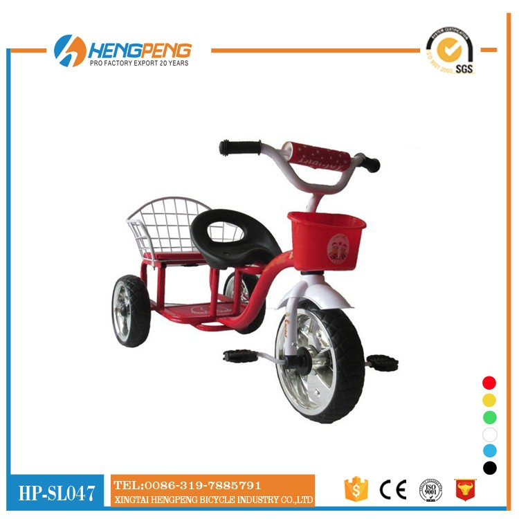 Children tricycle with push handle