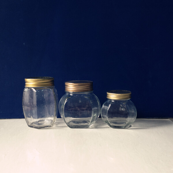 Glass Jar for Honey Pepper Sauce with Golden Tin Cap