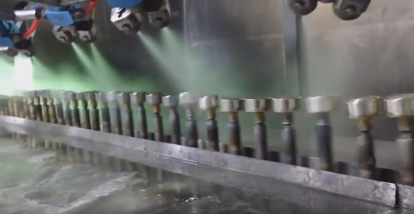Automatic spray paint line