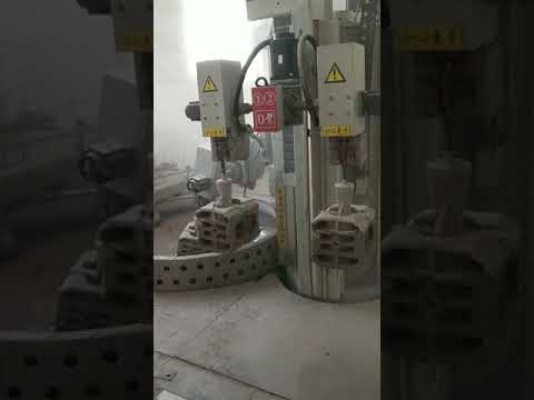 Fully automatic adhering sand robot