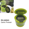 Garlic press with storage container
