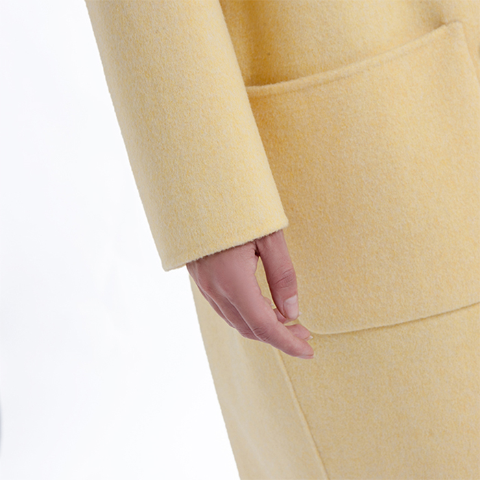 The sleeves of the new yellow cashmere winter coat
