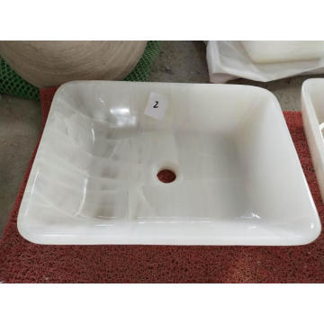 White round onyx vessel sink