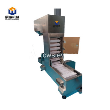 Bucket lifter conveyor for packing machine