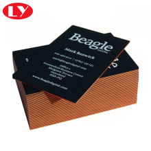 Black paper business card printed with gold edge