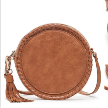 Tassel pendant braided leather round shoulder bag