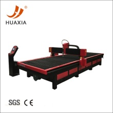Metal plasma cutting table with exhaust systems