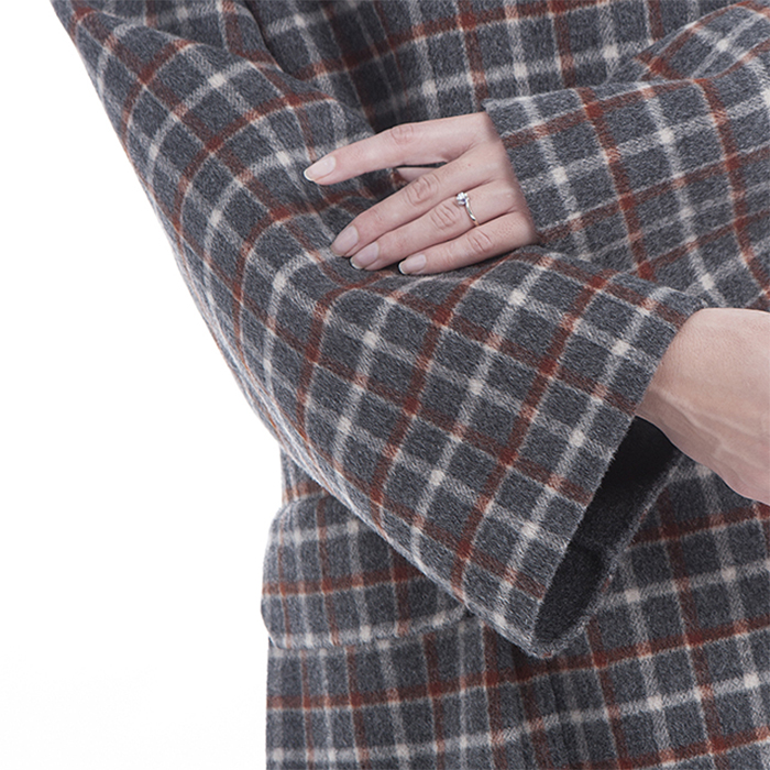 Sleeves of vintage Plaid winter clothes