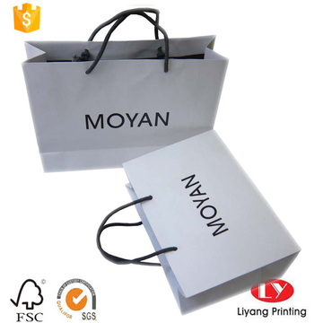white kraft paper bag with black logo