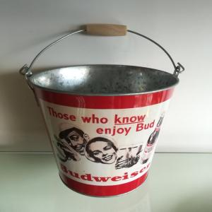 Bucket with wooden handle and bottle opener