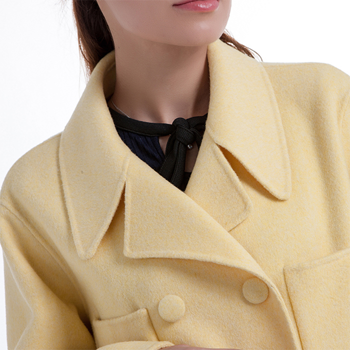 The collar of the new yellow cashmere winter coat