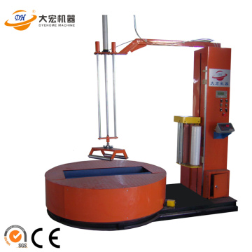 Fabric roll prestretch wrapping machine